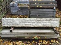 Stone faced gravel boards with concrete slotted posts. £13/ gravel board and £15/ post