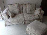 Large 2 seater sofa wing chair and pouffe. Fire labels still attached. Loose covers recently washed.