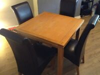 4 leather chairs and dinning table real wood