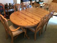 Stunning extending pine dining table in excellent condition.