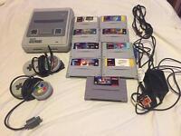 Super Nintendo snes 9 games 2 pads rare games console