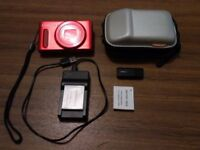Canon SX610HS Digital Camera with case, travel charger, memory card and two spare batteries.
