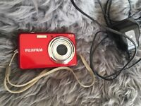 Fujifilm Digital camera with zoom and large screen. Includes charger, euro charger and case
