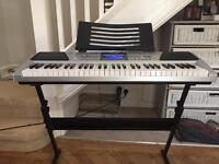 RockJam RJ661. 61. Key electronic interactive teaching piano keyboard with stand.