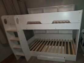 White bunkbeds with storage