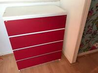 Red and white chest of drawers.