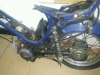 Yamaha 50cc moped scooter engine with frame and rear wheel
