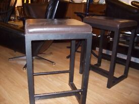 A set of five vintage Leather and metal stools