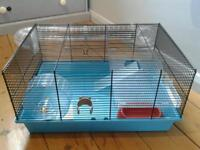 Hamster cage with tubes and wheel