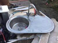 Old kitchen sink with taps