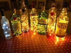 Christmas Present. Spirit Bottles with rice lights