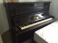 Upright Piano R.J Wade London made. EAST LONDON