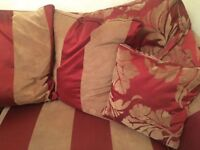 Red 3 seater sofa with soft cushions