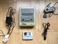 SNES console + game + controller and wires