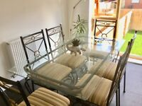 **Kitchen/Dining room table and set of 6x chairs.Glass table could be used outdoors in garden too?**