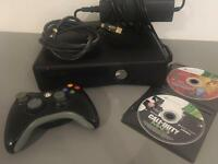 Xbox 360 slim with controller and 2 games