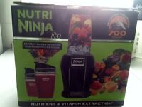 Nutri Ninja in box with original leaflets and recipe pamphlet and 2 containers £26