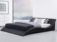 ITALIAN STYLE FAUX LEATHER CURVED KINGSIZE BED