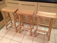 Three wooden breakfast bar stools