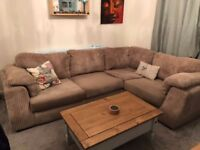 Large cream corner sofa with footstool