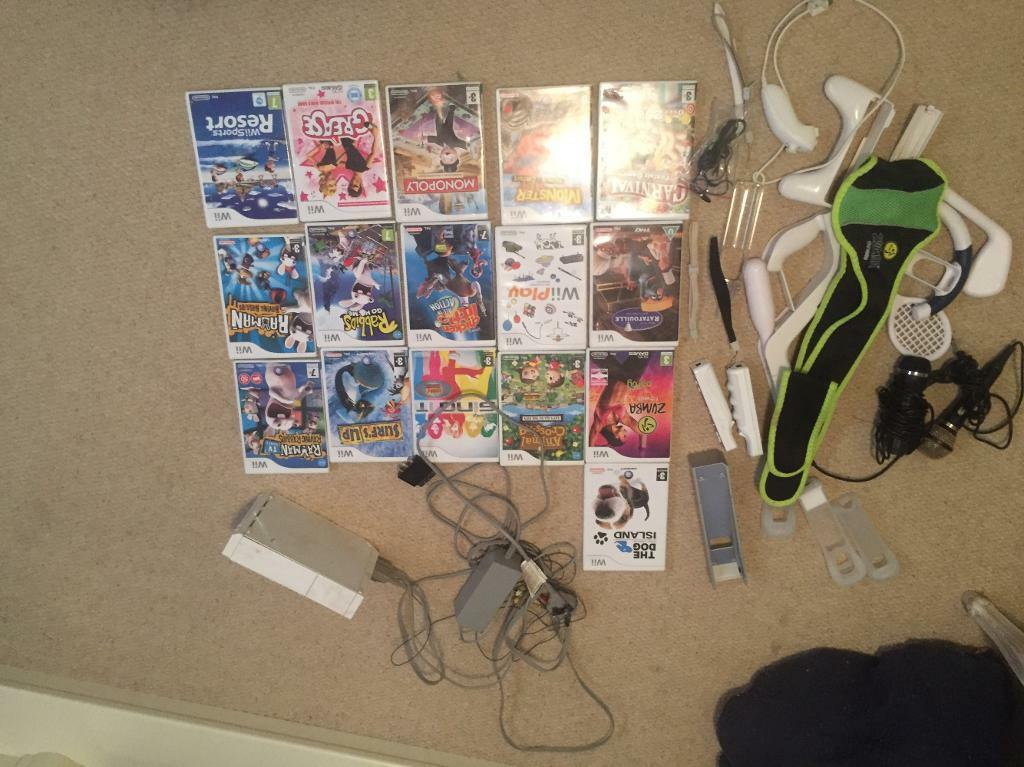 Wii with 16 games and tons of accessories