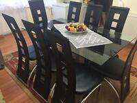 8 Chairs with black glass table for leaving room or kitchen