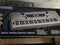 61 Key Silver Electronic Keyboard with Stand and original packaging