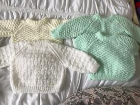 Hand made baby knitted cardigans and jumpers