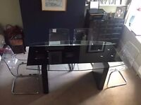 Priced to sell: contemporary glass dining table