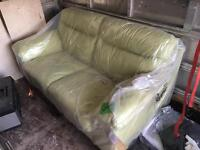 Brand new green leather two seater from dfs