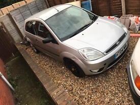 Silver Ford Fiesta black leather