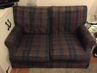 Two tartan two seater sofas