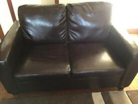 Immaculate 2 seater faux leather sofa