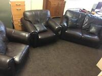 Brown leather settee 2 chairs and footstool.