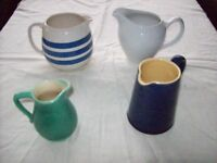 Collection of 4 small jugs