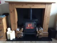 Oak fireplace with electric wood burner