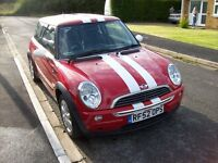 MINI ONE IN RED WITH WHITE STRIPES
