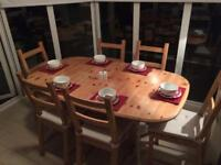 Extending solid wood dining table and 6 chairs