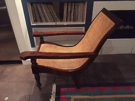 Elegant planter chair in Mahogany with Caning. Full functioning