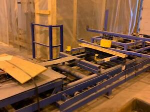 BAUTECH Lumber Lift Strapping System With In And Out Feed Conveyors