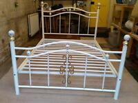 White metal double bed frame for sale. Can deliver.