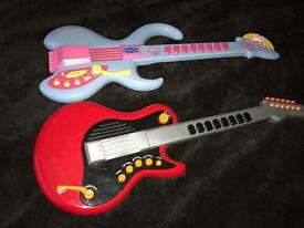 Two toy guitars
