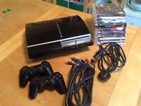 PlayStation 3 with 9 games and two controllers