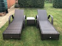 Rattan sunbeds and side table