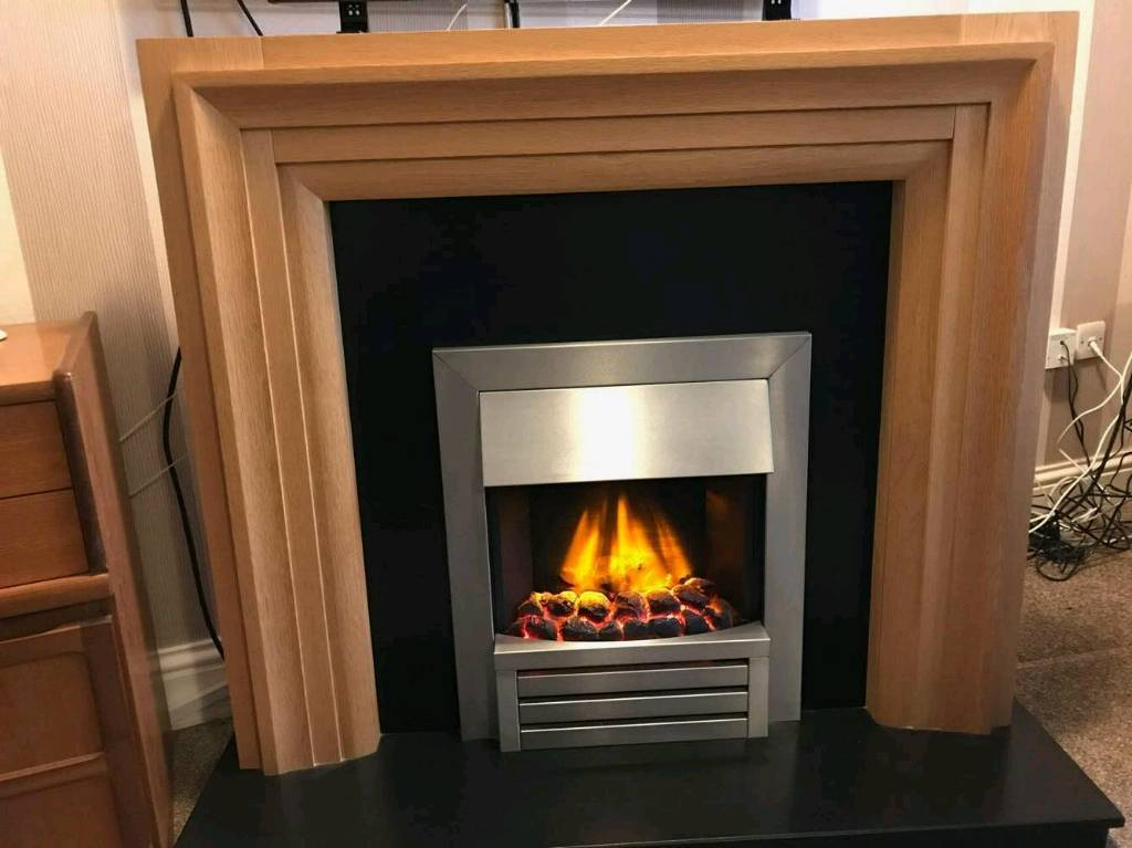 OAK wood effect fire surround with modern built in electric fire with flame/coal effect.