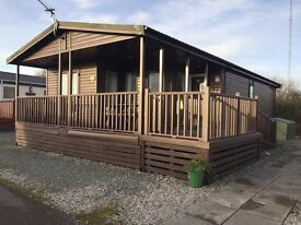2 BEDROOM LODGE FOR SALE. NOT STATIC CARAVAN SITED & READY TO OWN ON SEA VIEW HOLIDAY PARK MORECAMBE