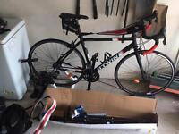Btwin triban 500 road bike & Elite Volare Turbo Trainer with accessories & bike workstand
