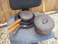 Cast iron saucepans and frying pan with wooden handles in excellent condition hardly used