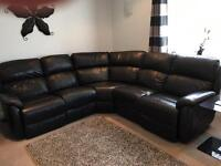 Black corner leather sofa electric recliner in both ends