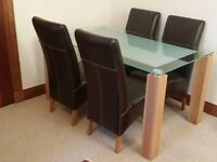 Immaculate Large Glass Dining Table with solid oak legs with 4 Genuine Leather Chairs
